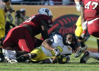 Clowney's hit takes cake on bowl season
