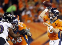 Manning's 7-TD night overwhelms Ravens