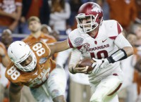 Arkansas plows over Texas to finish strong