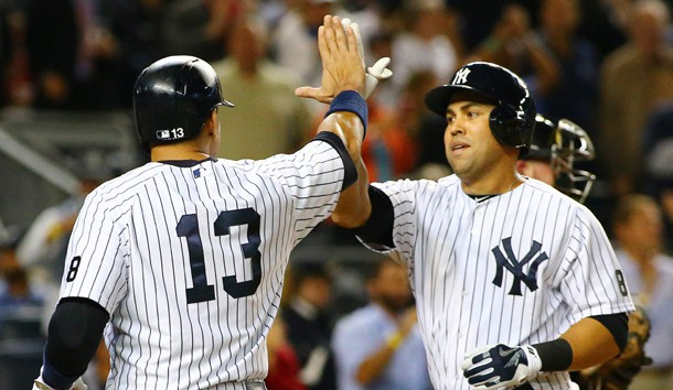 Sep 24, 2015; Bronx, NY, USA; New York Yankees right fielder Carlos beltran (36) is congratulated by designated hitter Alex Rodriguez (13) after hitting a three run home run against the Chicago White Sox in the third inning at Yankee Stadium. Mandatory Credit: Andy Marlin-USA TODAY Sports