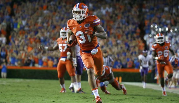 Sep 12, 2015; Gainesville, FL, USA;  Florida Gators defensive back Jalen Tabor (31) intercepts the ball and runs it back for a touchdown against the East Carolina Pirates during the second half at Ben Hill Griffin Stadium.  Florida Gators defeated the East Carolina Pirates 31-24. Mandatory Credit: Kim Klement-USA TODAY Sports