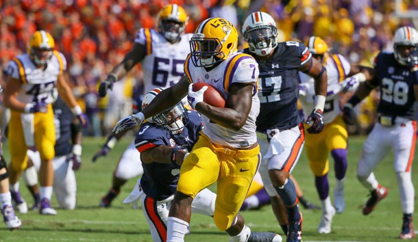 Sep 19, 2015; Baton Rouge, LA, USA; LSU Tigers running back Leonard Fournette (7) breaks a tackle by Auburn Tigers defensive back Jonathan Jones (3) during the second quarter of a game at Tiger Stadium. Mandatory Credit: Derick E. Hingle-USA TODAY Sports