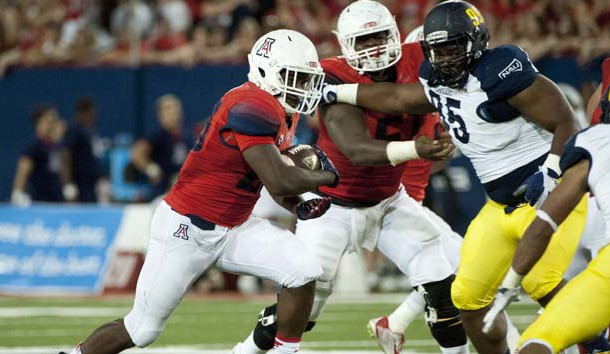 Sep 19, 2015; Tucson, AZ, USA; Arizona Wildcats running back Nick Wilson (28) runs the ball during the second quarter against the Northern Arizona Lumberjacks at Arizona Stadium. Mandatory Credit: Casey Sapio-USA TODAY Sports
