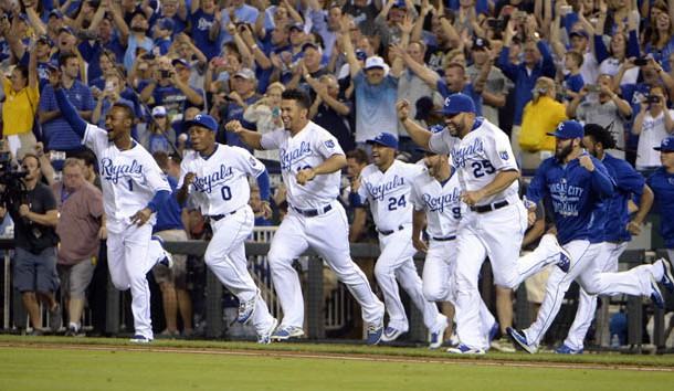 Sep 24, 2015; Kansas City, MO, USA; Kansas City Royals players celebrate after the game against the Seattle Mariners at Kauffman Stadium. Kansas City won the game 10-4 and won the American League central division. Mandatory Credit: John Rieger-USA TODAY Sports