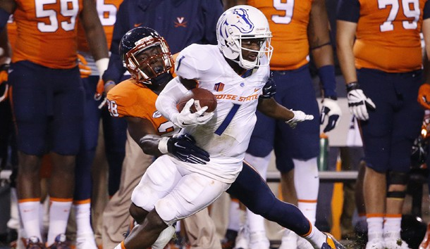 Sep 25, 2015; Charlottesville, VA, USA; Boise State Broncos wide receiver Shane Williams-Rhodes (1) runs with the ball as Virginia Cavaliers safety Wilfred Wahee (28) makes the tackle in the third quarter at Scott Stadium. Mandatory Credit: Amber Searls-USA TODAY Sports