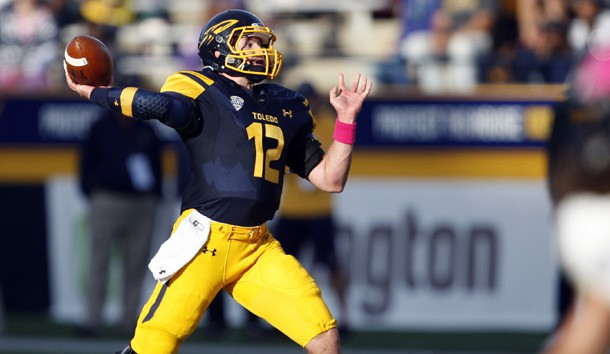 Oct 10, 2015; Toledo, OH, USA; Toledo Rockets quarterback Phillip Ely (12) throws the ball during the third quarter against the Kent State Golden Flashes at Glass Bowl. Rockets win 38-7. Mandatory Credit: Raj Mehta-USA TODAY Sports