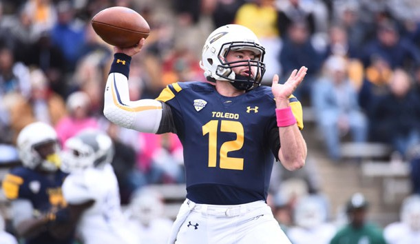 Oct 17, 2015; Toledo, OH, USA; Toledo Rockets quarterback Phillip Ely (12) drops back to pass during the first quarter against the Eastern Michigan Eagles at Glass Bowl. Mandatory Credit: Tim Fuller-USA TODAY Sports