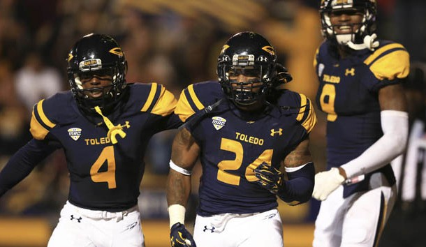 Sep 19, 2015; Toledo, OH, USA; Toledo Rockets wide receiver Corey Jones (4),  running back Damion Jones-Moore (24) and  wide receiver Alonzo Russell (9) celebrate after the game winning touchdown during the fourth at Glass Bowl. Toledo Rockets defeated Iowa State Cyclones 30-23. Mandatory Credit: Andrew Weber-USA TODAY Sports