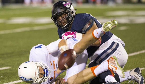 Oct 16, 2015; Logan, UT, USA; Boise State Broncos quarterback Brett Rypien (4) fumbles the ball forced by Utah State Aggies defensive end Ricky Ali'ifua (95) at Romney Stadium. Mandatory Credit: Rob Gray-USA TODAY Sports