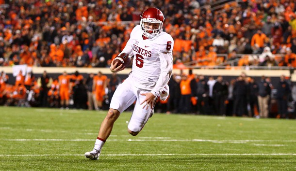 Nov 28, 2015; Stillwater, OK, USA; Oklahoma Sooners quarterback Baker Mayfield (6) runs the ball for a touchdown in the second half against the Oklahoma State Cowboys at Boone Pickens Stadium. The Sooners defeated the Cowboys 58-23. Mandatory Credit: Mark J. Rebilas-USA TODAY Sports