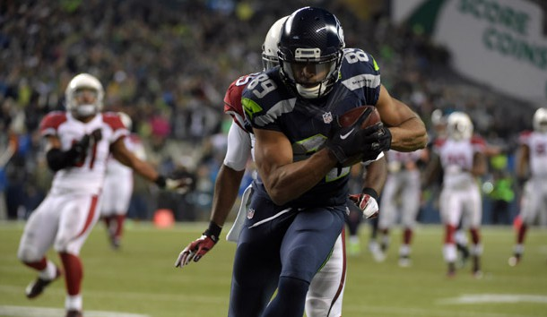 Nov 15, 2015; Seattle, WA, USA; Seattle Seahawks wide receiver Doug Baldwin (89) scores on a 32-yard touchdown reception in the third quarter against th e Arizona Cardinals during a NFL football game at CenturyLink Field. Mandatory Credit: Kirby Lee-USA TODAY Sports