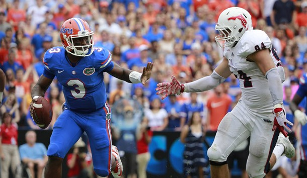 Nov 21, 2015; Gainesville, FL, USA; Florida Gators quarterback Treon Harris (3) scrambles against  Florida Atlantic Owls defensive lineman Hunter Snyder (94) during the second quarter at Ben Hill Griffin Stadium. Mandatory Credit: Kim Klement-USA TODAY Sports