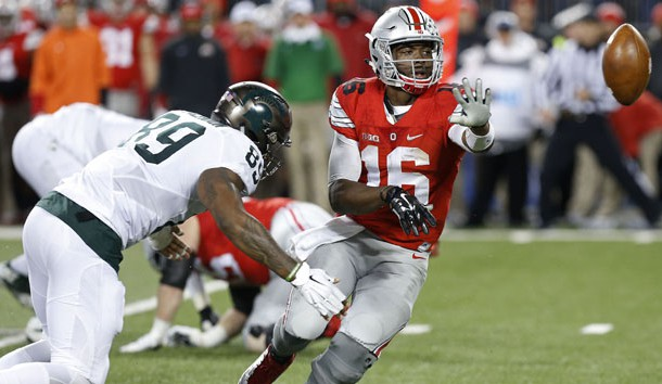 Nov 21, 2015; Columbus, OH, USA; Ohio State Buckeyes quarterback J.T. Barrett (16) pitches the ball as Michigan State Spartans defensive end Shilique Calhoun (89) defends in the fourth quarter at Ohio Stadium. The Spartans won 17-14. Mandatory Credit: Geoff Burke-USA TODAY Sports