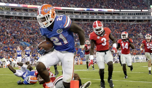 Oct 31, 2015; Jacksonville, FL, USA; Florida Gators running back Kelvin Taylor (21) runs the ball for a touchdown against the Georgia Bulldogs during the second half at EverBank Stadium. Florida Gators defeated the Georgia Bulldogs 27-3. Mandatory Credit: Kim Klement-USA TODAY Sports