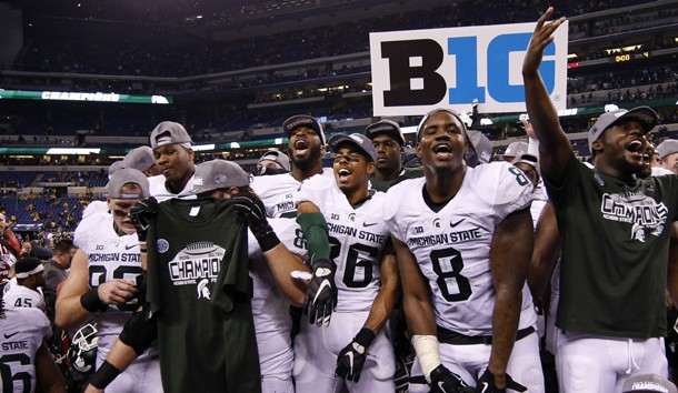 Dec 5, 2015; Indianapolis, IN, USA; Michigan State players celebrate after defeating the Iowa Hawkeyes during in the Big Ten Conference football championship game at Lucas Oil Stadium. Mandatory Credit: Brian Spurlock-USA TODAY Sports