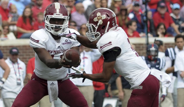 Oct 10, 2015; Oxford, MS, USA; New Mexico State Aggies quarterback Nick Jeanty (12) hands the ball off to running back Larry Rose III (3) during the game at Vaught-Hemingway Stadium. Photo Credit: Justin Ford-USA TODAY Sports