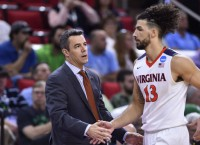 Coach goes down, but Virginia rolls to 81-45 win