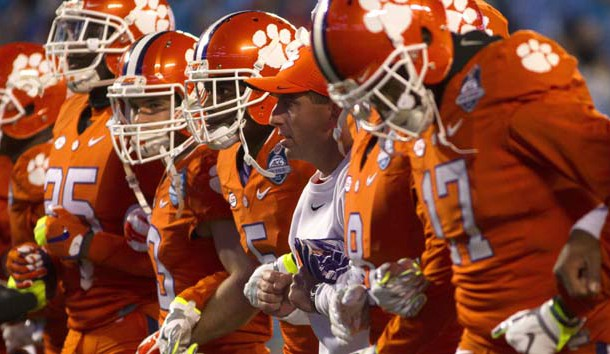 Dec 5, 2015; Charlotte, NC, USA; Clemson Tigers head coach Dabo Swinney (C) and his team prior to their ACC football championship game against the North Carolina Tar Heels at Bank of America Stadium. Photo Credit: Joshua S. Kelly-USA TODAY Sports