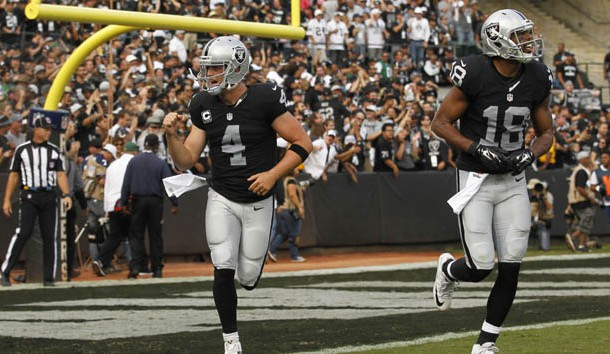 Nov 1, 2015; Oakland, CA, USA; Oakland Raiders quarterback Derek Carr (4) reacts after throwing a touchdown pass against the New York Jets in the third quarter at O.co Coliseum. The Raiders defeated the Jets 34-20. Photo Credit: Cary Edmondson-USA TODAY Sports
