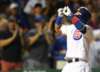 Baez, Russell blasts seal Cubs' win over White Sox