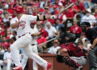 Cards' Holliday takes fastball to face