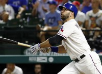 Moreland's two homers lead Rangers past Royals