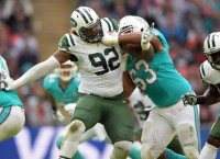 NFL Notes: Dolphins' LG Thomas holding off Tunsil