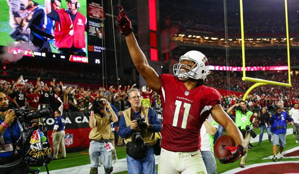 Jan 16, 2016; Glendale, AZ, USA; Arizona Cardinals wide receiver Larry Fitzgerald (11) celebrates after scoring the winning touchdown against the Green Bay Packers during overtime in a NFC Divisional round playoff game at University of Phoenix Stadium. Photo Credit: Mark J. Rebilas-USA TODAY Sports