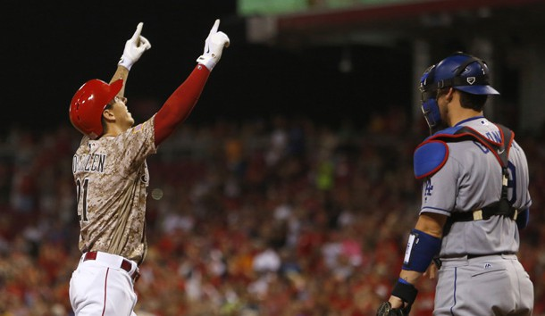 Aug 19, 2016; Cincinnati, OH, USA;  Cincinnati Reds relief pitcher Michael Lorenzen (21) reacts next to Los Angeles Dodgers catcher Yasmani Grandal (9) after Lorenzen hit his first career home run, a three-run home run, during the seventh inning at Great American Ball Park. The Reds won 9-2. Photo Credit: David Kohl-USA TODAY Sports