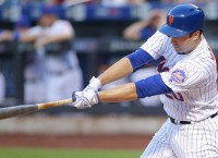 Mets snap slide with 11-inning victory