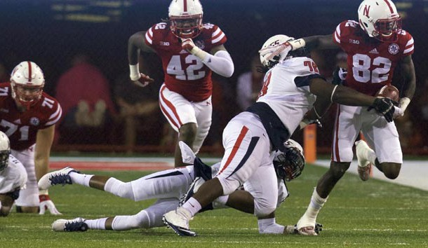 Sep 12, 2015; Lincoln, NE, USA; South Alabama Jaguars defensive lineman Tre Alford (78) tackles Nebraska Cornhuskers wide receiver Alonzo Moore (82) in the second half at Memorial Stadium. Nebraska won 48-9. Photo Credit: Bruce Thorson-USA TODAY Sports