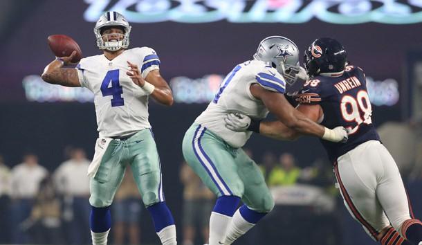 Sep 25, 2016; Arlington, TX, USA; Dallas Cowboys quarterback Dak Prescott (4) throws in the pocket against the Chicago Bears at AT&T Stadium. Photo Credit: Matthew Emmons-USA TODAY Sports