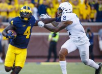No. 4 Michigan faces test versus No.8 Wisconsin