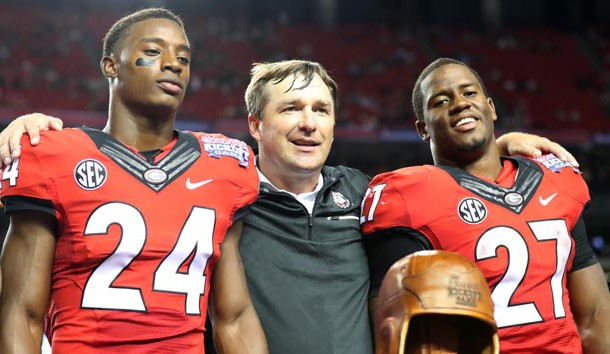 Sep 3, 2016; Atlanta, GA, USA;  Georgia Bulldogs head coach Kirby Smart celebrates with safety Dominick Sanders (24) and running back Nick Chubb (27) after the 2016 Chick-Fil-A Kickoff game against the North Carolina Tar Heels at Georgia Dome. Georgia won 33-24. Photo Credit: Jason Getz-USA TODAY Sports