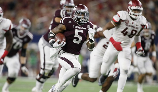 Sep 24, 2016; Dallas, TX, USA; Texas A&M Aggies running back Trayveon Williams (5)  runs for a touchdown in the fourth quarter against Arkansas Razorbacks defensive lineman Deatrich Wise Jr. (48)  at AT&T Stadium. Photo Credit: Tim Heitman-USA TODAY Sports