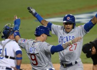 Russell powers Cubs within a win of World Series