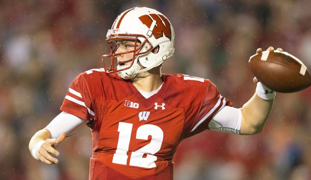Oct 15, 2016; Madison, WI, USA; Wisconsin Badgers quarterback Alex Hornibrook (12) throws a pass during the first quarter against the Ohio State Buckeyes at Camp Randall Stadium. Photo Credit: Jeff Hanisch-USA TODAY Sports