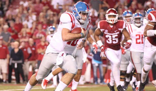 Oct 15, 2016; Fayetteville, AR, USA;  Ole Miss Rebels quarterback Chad Kelly (10) rushes for a touchdown in the second quarter against the Arkansas Razorbacks at Donald W. Reynolds Razorback Stadium. Photo Credit: Nelson Chenault-USA TODAY Sports