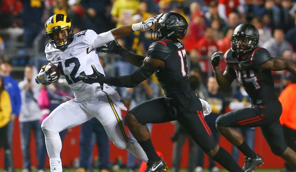 Oct 8, 2016; Piscataway, NJ, USA;  Michigan Wolverines running back Chris Evans (12) runs with the ball while avoiding a tackle attempt by Rutgers Scarlet Knights defensive back K.J. Gray (17) during the second half at High Points Solutions Stadium. Michigan defeated Rutgers 78-0.  Photo Credit: Ed Mulholland-USA TODAY Sports