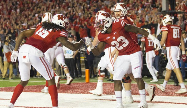 Oct 29, 2016; Madison, WI, USA;  Wisconsin Badgers running back Dare Ogunbowale (23) and wide receiver Robert Wheelwright (15) celebrate after scoring a touchdown during overtime against the Nebraska Cornhuskers at Camp Randall Stadium.  Wisconsin won 23-17.  Photo Credit: Jeff Hanisch-USA TODAY Sports