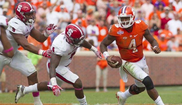 Oct 15, 2016; Clemson, SC, USA; Clemson Tigers quarterback Deshaun Watson (4) carries the ball while being defended by North Carolina State Wolfpack linebacker Jerod Fernandez (4) during the second half at Clemson Memorial Stadium. Tigers won 24-17. Photo Credit: Joshua S. Kelly-USA TODAY Sports