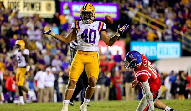 Oct 22, 2016; Baton Rouge, LA, USA; LSU Tigers linebacker Duke Riley (40) celebrates as Mississippi Rebels quarterback Chad Kelly (10) looks on following a defensive stop during the second half of a game at Tiger Stadium. LSU defeated Mississippi 38-21. Photo Credit: Derick E. Hingle-USA TODAY Sports