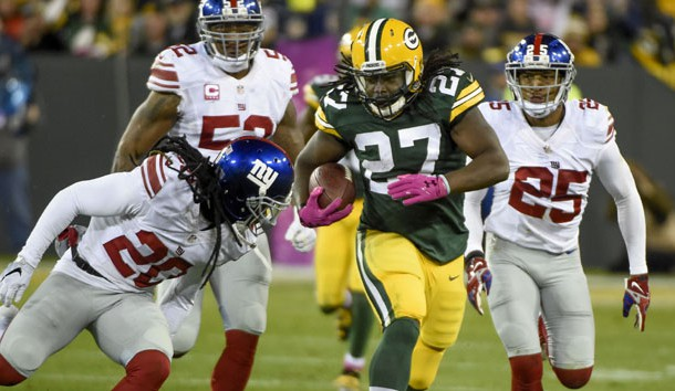 Oct 9, 2016; Green Bay, WI, USA;  Green Bay Packers running back Eddie Lacy (27) breaks free for a first down against New York Giants cornerback Janoris Jenkins (20) and cornerback Leon Hall (25) in the second quarter at Lambeau Field. Photo Credit: Benny Sieu-USA TODAY Sports