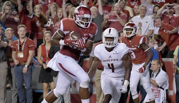 Hurts, Alabama defense lead way in 49-30 win over Arkansas