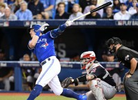 Jays avoid elimination with Game 4 win vs. Indians