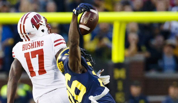 Oct 1, 2016; Ann Arbor, MI, USA; Michigan Wolverines cornerback Jourdan Lewis (26) intercepts a pass intended for Wisconsin Badgers wide receiver George Rushing (17) in the fourth quarter at Michigan Stadium. Michigan won 14-7. Photo Credit: Rick Osentoski-USA TODAY Sports