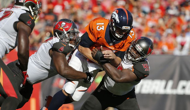 Oct 2, 2016; Tampa, FL, USA;  Tampa Bay Buccaneers defensive tackle Akeem Spence (97) and defensive tackle Clinton McDonald (98) tackle Denver Broncos quarterback Trevor Siemian (13) during the first half at Raymond James Stadium. Photo Credit: Kim Klement-USA TODAY Sports