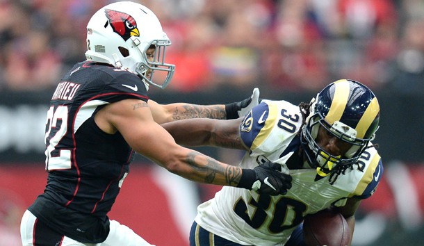 Oct 2, 2016; Glendale, AZ, USA; Arizona Cardinals free safety Tyrann Mathieu (32) attempts to tackle Los Angeles Rams running back Todd Gurley (30) during the second half at University of Phoenix Stadium. The Rams won 17-13. Photo Credit: Joe Camporeale-USA TODAY Sports