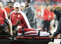 Nebraska QB Armstrong taken off field on stretcher