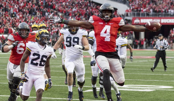Nov 26, 2016; Columbus, OH, USA; Ohio State Buckeyes running back Curtis Samuel (4) scores the winning touchdown in the second overtime under pursuit from Michigan Wolverines cornerback Jourdan Lewis (26) at Ohio Stadium. Ohio State won the game 30-27 in double overtime. Photo Credit: Greg Bartram-USA TODAY Sports